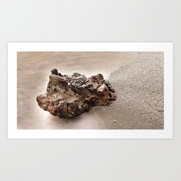 A rock on the shore Art Print