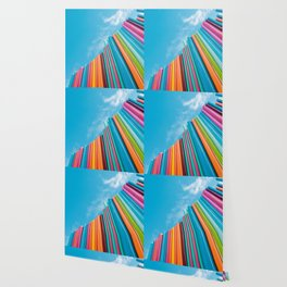 Colorful Rainbow Pipes Against Blue Sky Wallpaper