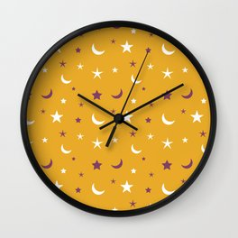Orange background with purple and white moon and star pattern Wall Clock