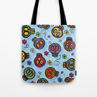 sugar skulls Tote Bags featuring Sugar Skulls by Kara Peters