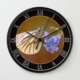 White and cream butterfly on forget-me-not flowers Wall Clock