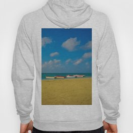 Colorful Boats Adorn the Tranquil Beach Hoody