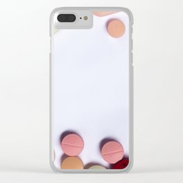 Numerous colorful pills on white background. Clear iPhone Case