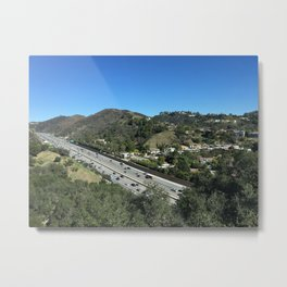 City in mountains, highway passing through Metal Print