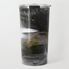 Relaxing water cascading over a moss covered rock Travel Mug