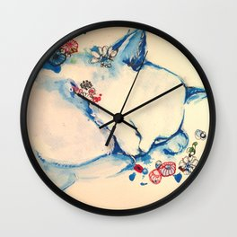 Cat sleeping with flowers Wall Clock