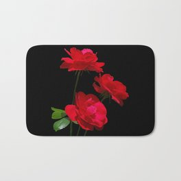 Red roses on black background Bath Mat