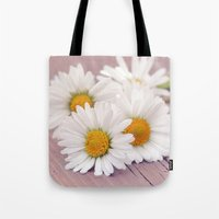 daisies Tote Bags featuring Daisies. by Mary Berg