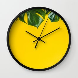 Tropical leaves on yellow background, space for text Wall Clock