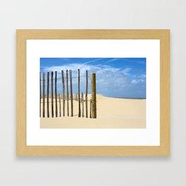Fence in the sand Framed Art Print