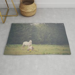Two horses in a field print Rug
