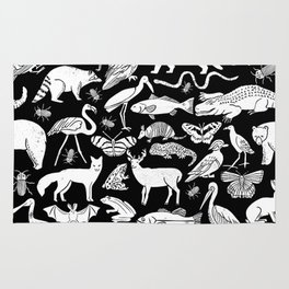 Linocut animals nature inspired printmaking black and white pattern nursery kids decor Rug