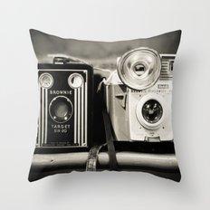 A pair of Kodak Brownies Throw Pillow