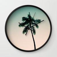 palm tree Wall Clocks featuring palm tree by noirblanc777