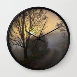 Foggy sunrise Wall Clock