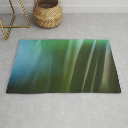 Vintage looking homemade photo of green grass. Rug