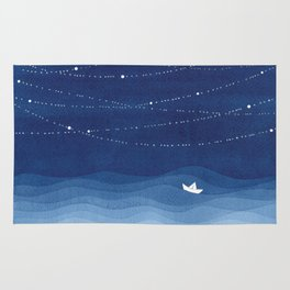 Follow the garland of stars, ocean, sailboat Rug