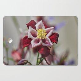aquilegia flower in bloom in the garden Cutting Board