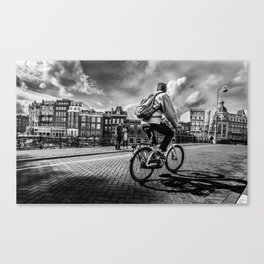 Biker over a bridge in Amsterdam Canvas Print