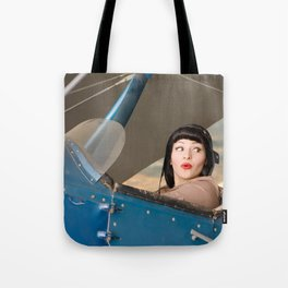 """Plucky Pilot"" - The Playful Pinup - Pilot Pin-up Girl in Airplane by Maxwell H. Johnson Tote Bag"