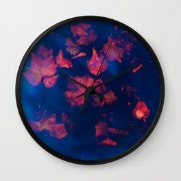 Rusty red falling leaves in dark blue water Wall Clock
