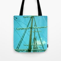 sailboat Tote Bags featuring sailboat by Vickn