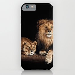 Cute lion and lioness - happy big cat family lie on the wooden log. Beautiful animals photo on dark background iPhone Case