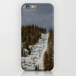 Empty chairlift at Taos Ski Valley in Taos, New Mexico on dark, gloomy day in autumn forest iPhone Case