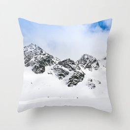 Switzerland mountains covered in snow in the winter blue skies Throw Pillow