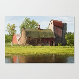 Old barn in Fall colors Canvas Print