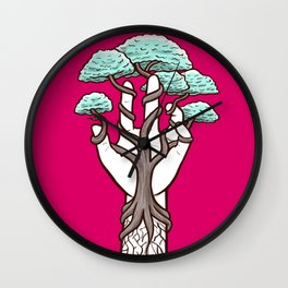 Tree growing within a hand – interlacing of nature and humanity Wall Clock