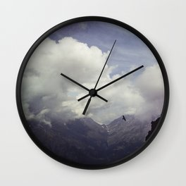 clouds over mountains Wall Clock