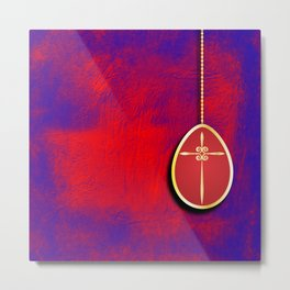 Gold cross in red egg hanging against a rich red and purple Metal Print