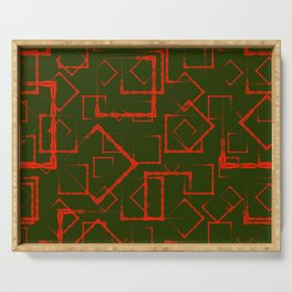 A lot of red rhombuses and squares in chaos on a green background. Serving Tray