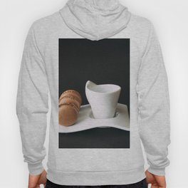 Set of cup of coffee and macaroons against black background Hoody