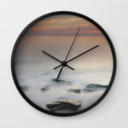 Calm red sunset at the beach Wall Clock