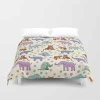 tigers Duvet Covers featuring Daisies, Tigers and Elephants by TigaTiga Artworks