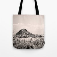 monkey island Tote Bags featuring Monkey Island, Southland, New Zealand by the penny drops