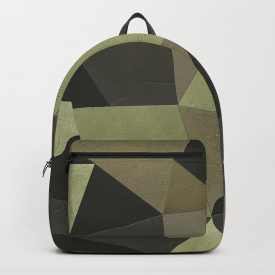 Black shabby green patches of the skin . Backpack