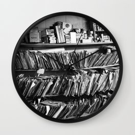 Overly stacked vinyl record shelves and other junk Wall Clock