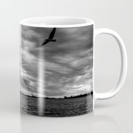 Sunset in black and white on the lake. Storm clouds. Small bird flying. Coffee Mug