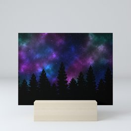 Silhouette tree against a starry night Mini Art Print