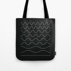 between waves Tote Bag