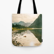 Mountain Reflecting the Lake in Many Glacier  Tote Bag