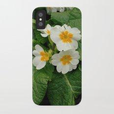 Little primula flower at the park iPhone X Slim Case