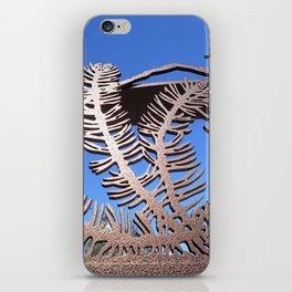 Pine branch blue skies iPhone Skin