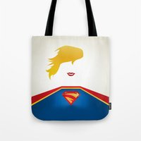 supergirl Tote Bags featuring SUPERGIRL by Roboz