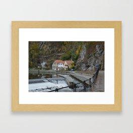 Colorful houses near a river Framed Art Print