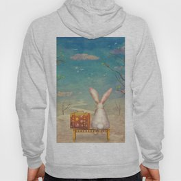 Sad rabbit  with suitcase sitting on the bench on the cloud in sky  Hoody