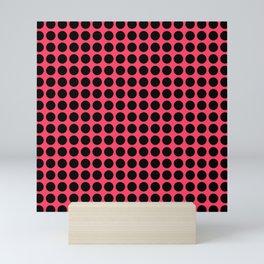 Black polka dots on a salmon color background . Mini Art Print